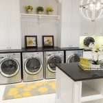gorgeou modern laundry room with recessed laundry room shelf idea  and four washing machine and black white island