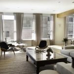 gorgeous and luxurious apartment interior design with industrial and modern touch of sofa with glass coffe table