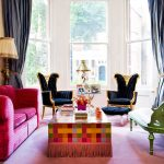 Gorgeous And Luxurious Apatrment Living Room Design With Bohemian Style And Black Wing Chair With Pink Sofa And Colorful Table Cloth On The Coffee Table With Green Bench