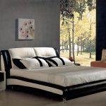 gorgeous black and white worth platform bed design in bedroom with open plan and wooden floor