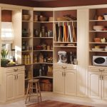 gorgeous creamy kitchen cabinet planner idea with large pottery decoration and small stool