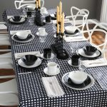 Gorgeous Dining Table Centerpiece Design With Black And White Dinnerware And French Black Table Cloth With Candle Chandelier And White Chairs