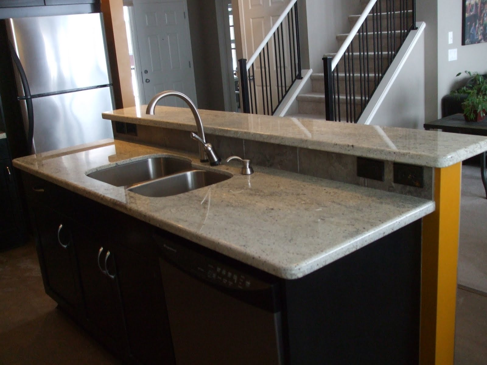 Stainless Steel Kitchen Faucet On Granite
