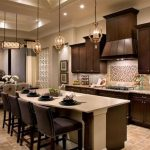 gorgeous kitchen design in amaerican house dsign with wooden cbainet and kitchen bar and black letaher stools and pendant lamps