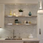 gorgeous kitchen idea with stone backsplash and white cabinet and pendants and stainless steel floating shelf