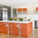 gorgeous orange white kitchen interior design with acrylic stools and indoor plants and wooden floor and gray accent