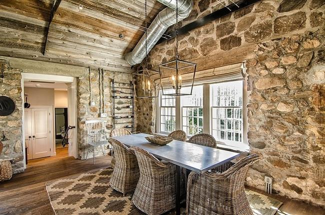 Gorgeous Rustic Stone House Interior Design With Stone Wall And Rattan