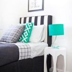gorgeous small bedding in black color with turquoise accent table lamp and stripe patterned simple headboard