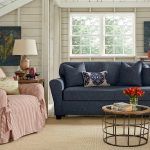 gorgeous white interior loft design with navy blue sofa and pink loveseat slipcober design with metal round coffee table