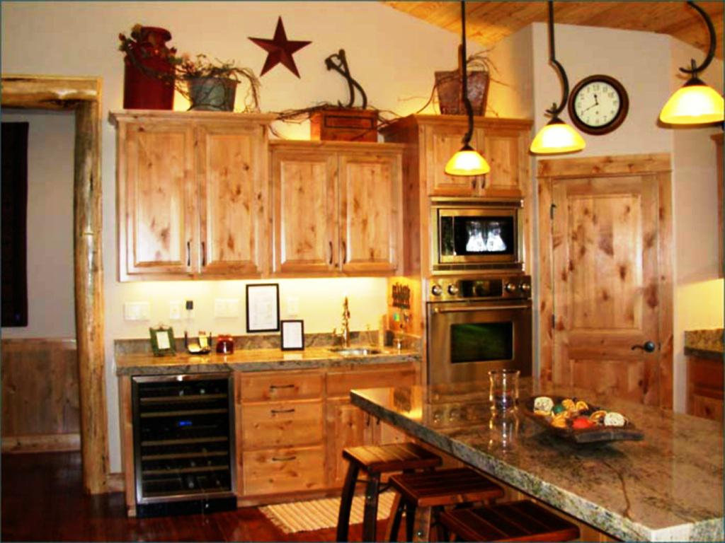 gorgeous wooden kitchen cabinet planner idea in traditional kitchen with christmas decoration and marble top and