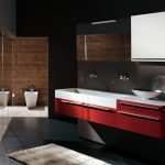 gorgoue dark bath with modern detail and floating red vanity with wall mirror and glass enclosure and black flooring
