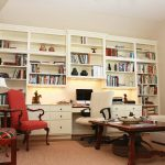 great free standing bookshelves with abundant cabinetry system featuring desk for home office decorated with white swivel chair and red arm chairs plus walnut table