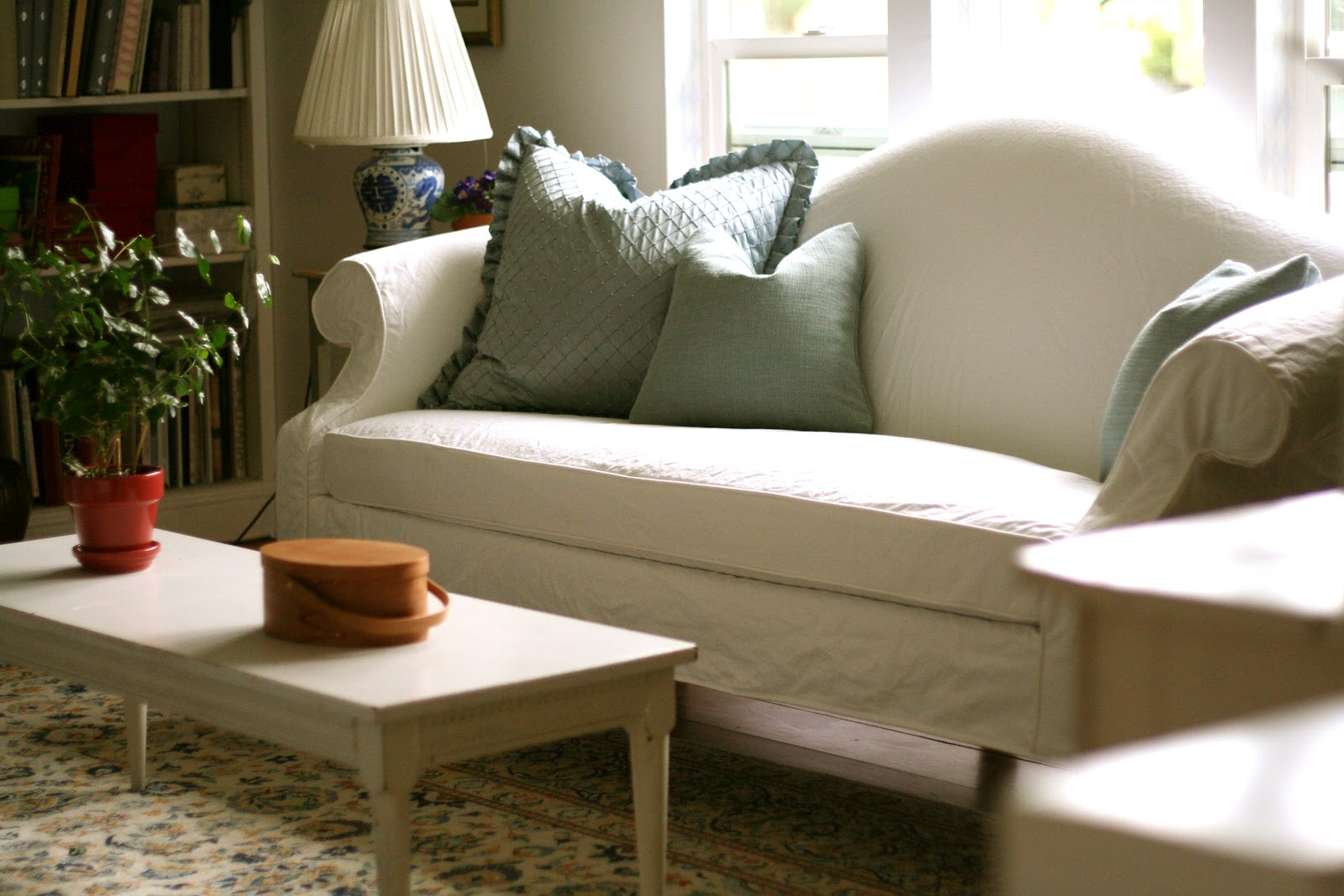 Great White Slip Cover For Sectional Design With Gray Pillows And Lng  Wooden Coffee Table And