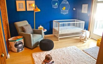 grey-racoon-storage-bin-by-3-sprouts-near-the-nursery-chair-with-black-ottoman-and-a-white-crib-with-blue-color-for-the-wall-with-wooden-floor