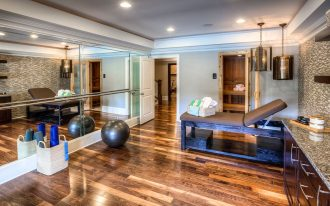 home gym essentials in modern desin with bed and mirror wall plus hardwood floor and unique pendant lamp