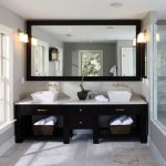 images of bathroom vanities in comtemporary design plus drawers combined with white countertops and ceramic vessel sinks feat large framed mirror