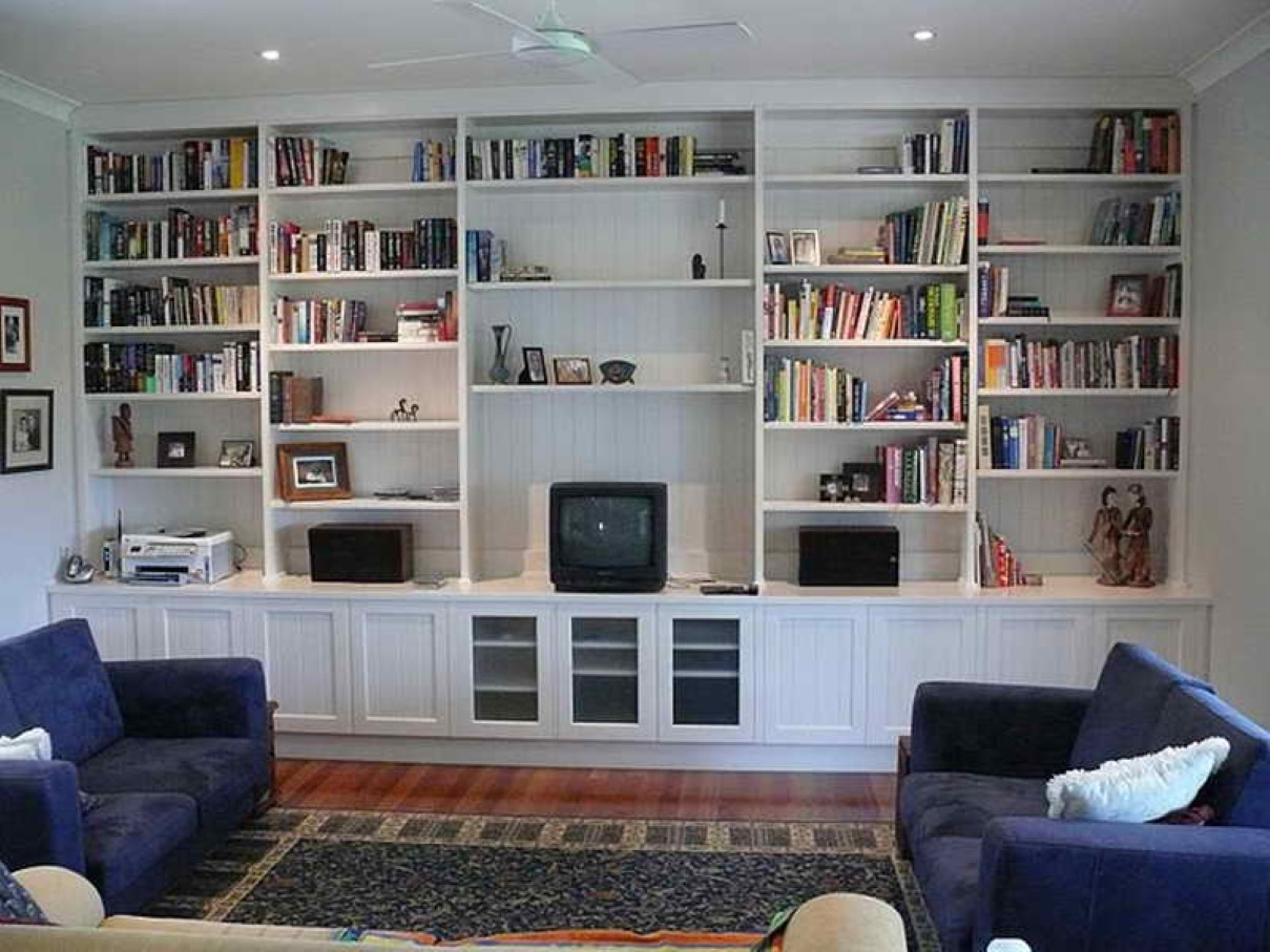 Living Room Design With Long Console Table And White Built In Bookshelves Purple Sofa