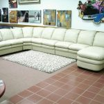 long sectional sofa with comfortable appearance together with white rug and pictures on wall decoration