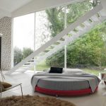 lovable bedroom interior design with open plan and gray round bed with white staircase and brown furry rug and creamy chair