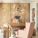 lovable dining room idea with bamboo siding and coral colored wing chairs and wooden table and wooden bench