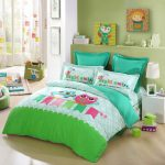 lovable green and blue owl bedding sheet with turquoise pillows and white end table and owl printed curtain idea and wall racks