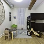 lovable kids bedroom in apartment with black frame and cute bicycle and wooden floor and gray area rug and small table set