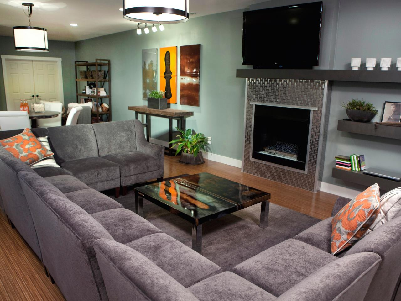 Lovable Purple Long Sectional Sofa Design With Brown Glossy Wooden Coffee  Table With Orange Cushions Before