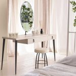 lovable white pink vintage dressing table with storage and rund mirror and round upholstered bench in luxurious bedroom design