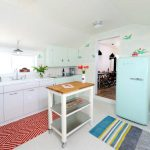 lovale kitchen design with red patterned area rug and white cabinet and white tan kitchen cart with wheels