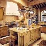 lovely and glamourous kitchen design with kitchen island and bar stool plus decorative rug and pot rack with lights