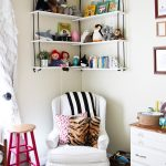 lovely hanging wall diy shelves design with black rope and white board slot above white chair with zebra cushion and pink end table