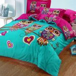 luxurious and tender retro owl bedding sheet in blue and magenta combination on wooden floor with white end table and chair