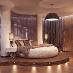 luxurious bedroo design with unique shape and suspended ceiling and wooden floor and siding and white round bed
