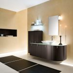 luxurious creamy bathroom design with brown floating vanity and wall lamps and triple sectioned black contemporary rug