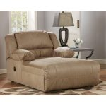 luxurious creamy comfy chair for bedroom design with lovable creamy tone and wooden floor and patterned area rug