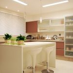 luxurious creamy small kitchen design with brown cbainetry and glass door cupboard and white island and white stools and indoor plants