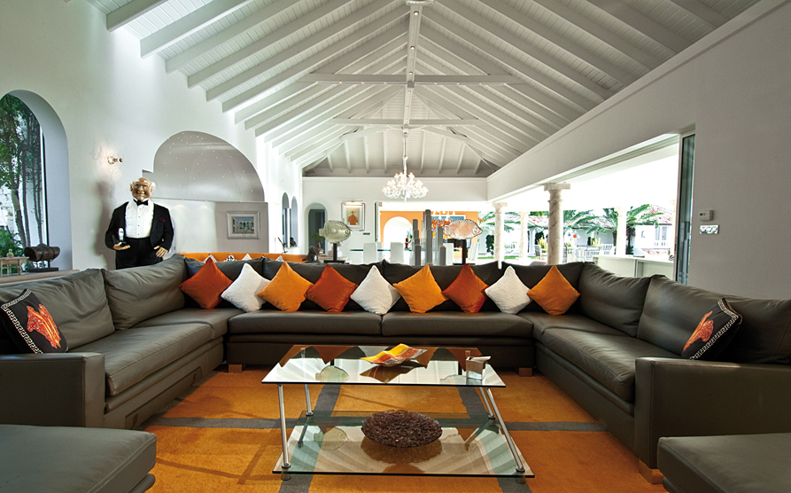 Elegant Luxurious Interior Design With Long Black Sectional Sofa Design With  Colorful Cushions In White Orange And Part 23