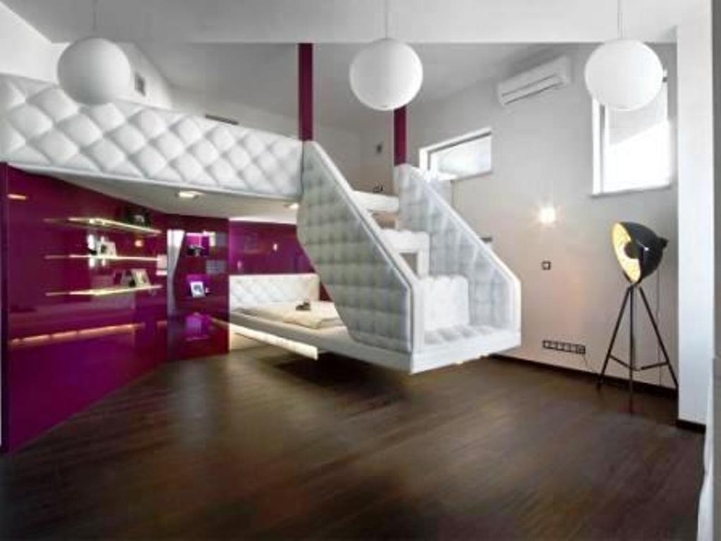 Luxurious Interior Design With Sophisticated Purple Glossy Wall Decor And  Adorable White Upholster Railing And Wooden