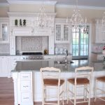 luxurious kashmir white granite countertops in white kitchen ideas with cozy kitchen island with comfortable bar stools with back and wooden flooring