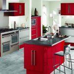 luxurious red kitchen cabinet planner idea with seating and black marble top and modern appliance and concrete flooring
