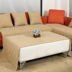 luxurious sectional sofa design with large creamy coffee table with brown cloth and orange accent pillow
