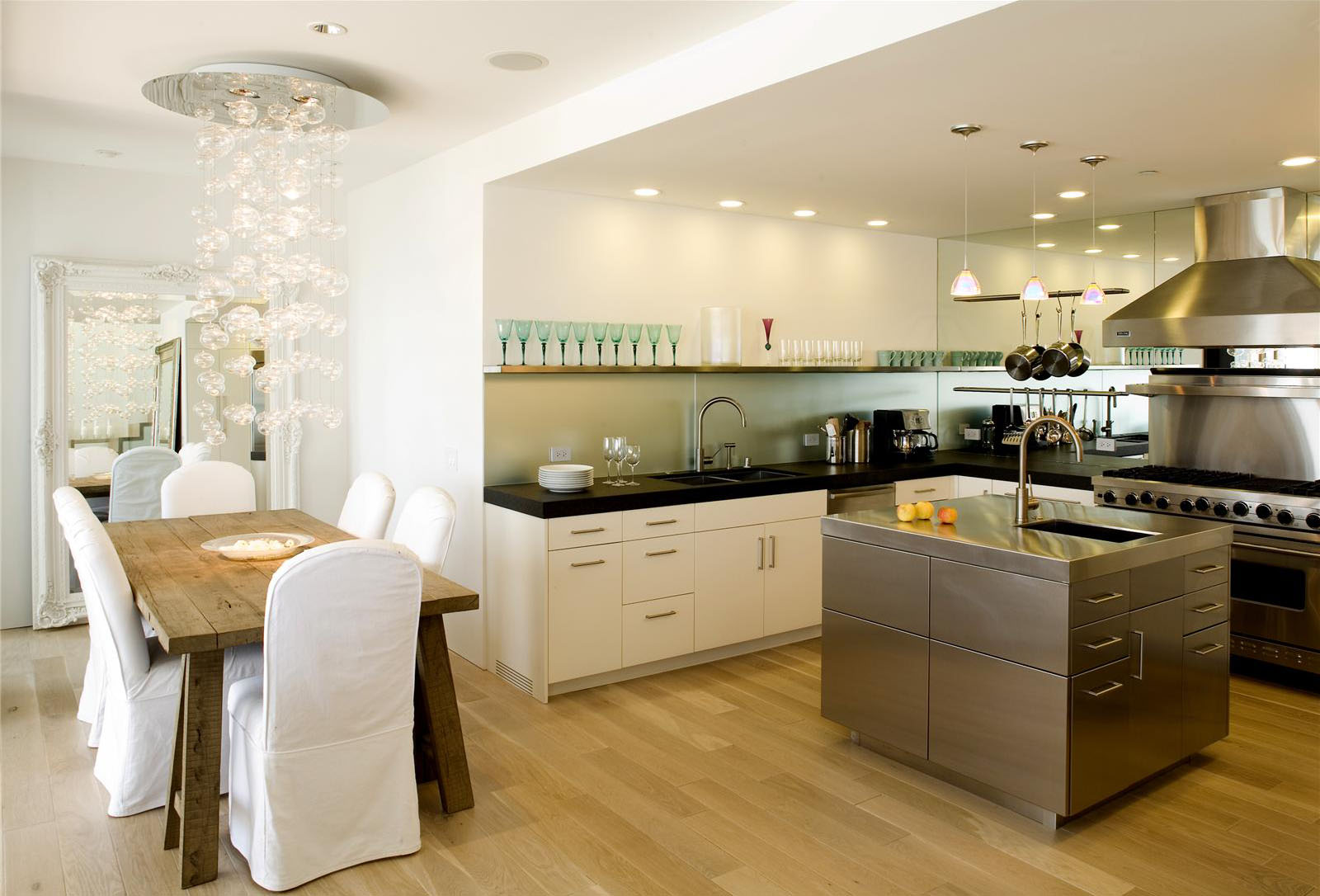 Luxurious White Open Kitchen Design Idea With White Cabinet And Stainless  Steel Island And Wooden Dining