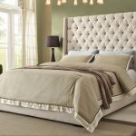 Luxury Bedroom Ideas With Super Comfy Tall Upholstered Bed And Tufted Headboard And Modern Rug Plus Brown Finish Wooden Nightstand With Drawers And Black Table Lamp