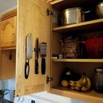 magnetic-strip-knives-for-knives-and-other-kitchen-utensils-mounted-inside-the-wooden-cabinet-door-above-the-stove-for-display-away-from-children