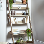 mesmerizing ladder shelving unit with wooden shelves beautified with dazzing plants and comfy ottoman