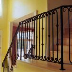 minimalist wrought iron stair railings interior with gorgeous staircase and yellow painted wall
