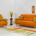 modern and minimalist orange sofa design with green cushion idea and patterned area rug and potted plant