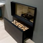 modern-hidden-firewood-drawer-box-to-store-the-logs-underneath-the-fireplace-and-the-drawer-rolls-out-to-show-the-deep-space-for-the-logs
