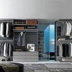 modern interior design of bedroom with luxurious walk in wardrobe idea with open plan and gray color