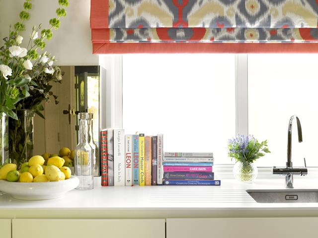 modern kitchen design idea with white cabinet with curved faucet with indoor plant and books and modern appliance